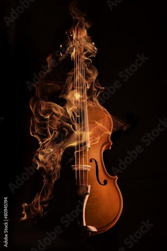 violin on fire over black bg