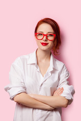 Smiling student girl in white shirt and red glasses