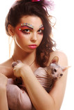 woman with creative visage holding Sphynx cat