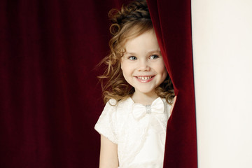 Portrait of cheerful pretty girl with ringlets