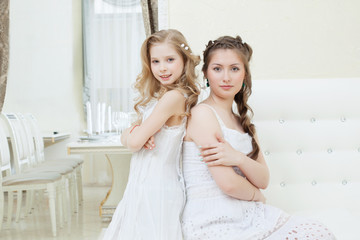 Lovely young models posing in restaurant