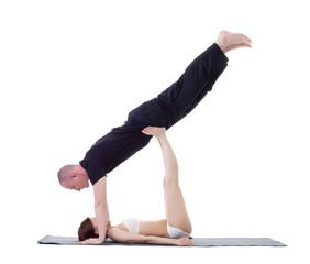 Studio shot of athletic trainers practicing yoga