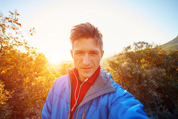 young man on the morning mountains background