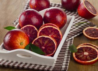 Fresh blood oranges in  white box