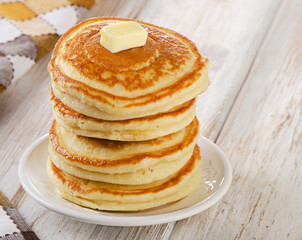 Stack of Small pancakes on  white wooden table
