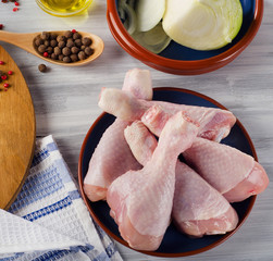 Fresh raw chicken legs  with spices.