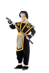 Little boy posing in ninja costume with katana