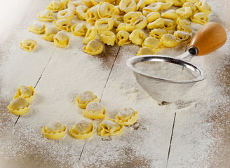 Freshly Made Ravioli pasta on  wooden table