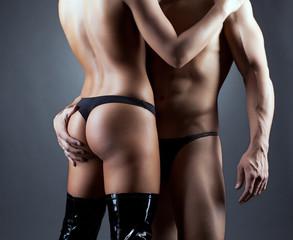 Muscular man hugging elastic female ass