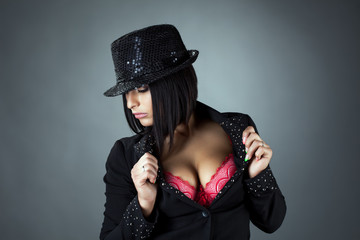 Portrait of hot busty brunette posing in hat