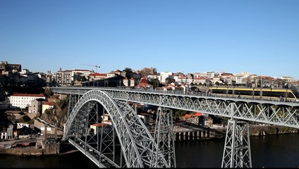 Afternoon in Porto city and Dom Luís I bridge, Portugal.