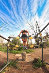 bodybuilder at parallel bars