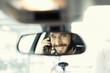 Leinwanddruck Bild - Cheerful man on mobile phone in the car