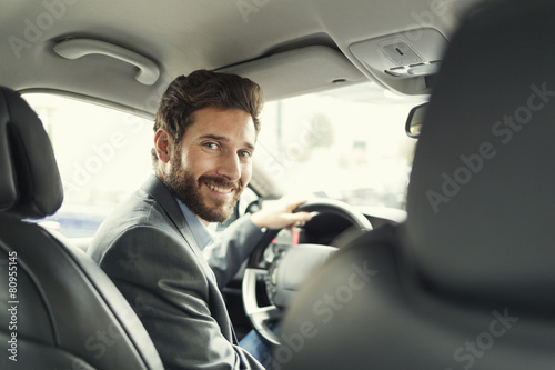 Portrait of man in his car. looking at camera - 80955145