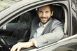 Leinwanddruck Bild - Portrait of man in his car. looking at camera