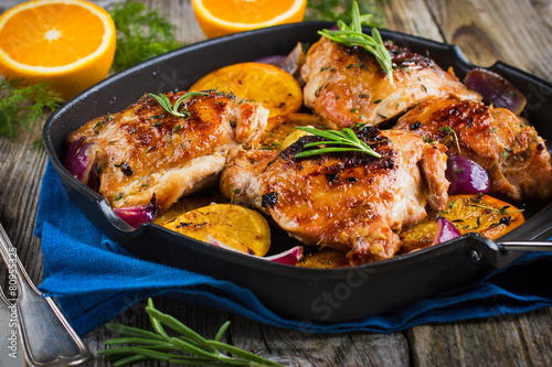 Fotobehang Vlees Roasted chicken with oranges and herbs