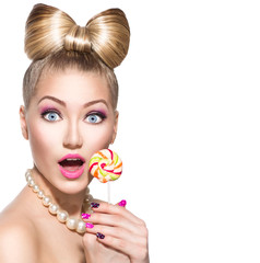 Beauty fashion model girl eating colourful lollipop