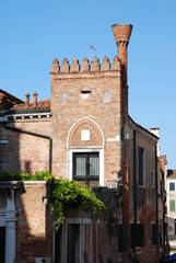 The brick house with a flue on the street of Venice.