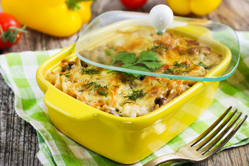 pasta, mushrooms and cheese gratin in casserole dish