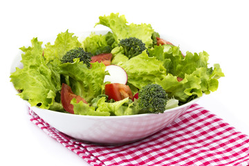 vegetables in bowl with napkin on a white background