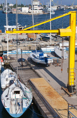 Yellow crane, sailing yachts and pleasure boats, Varna port