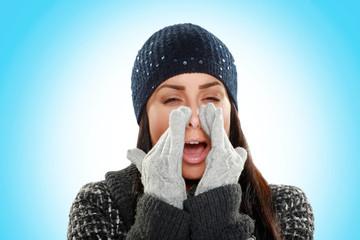 woman sneezes