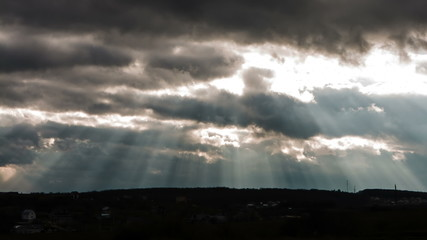 Sun beam in Dark Clouds and Sky before Thunderstorm