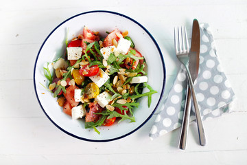 Watermelon salad with feta cheese and arugula, toasted almonds