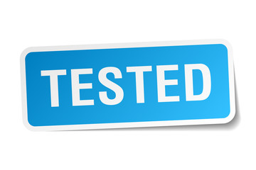 tested blue square sticker isolated on white