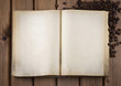 Top view of blank old book with cofee beans