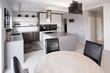 Modern furniture in designed kitchen