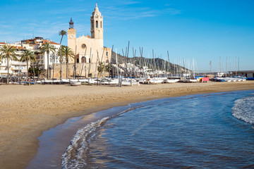 The church and the beach in Sitges, a small town near Barcelona