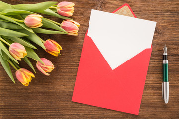 Flowers, envelope and pen