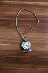 Vintage pocket watch on table