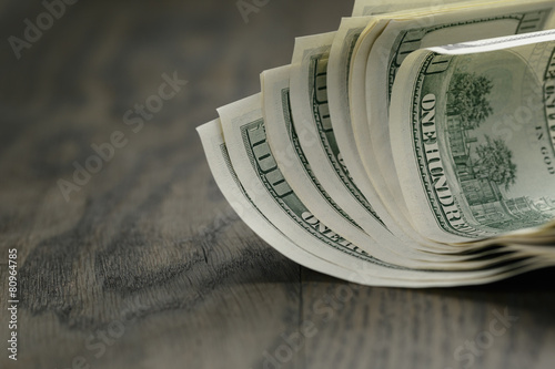 Keuken foto achterwand Boodschappen hundred dollar bills on wood table