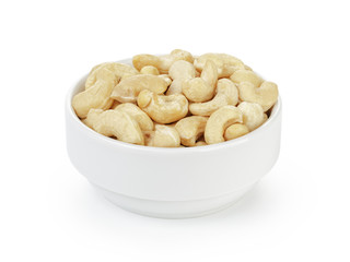 dry cashew nuts in bowl on white