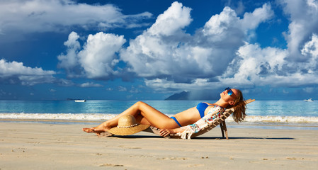 Woman in bikini lying on beach at Seychelles