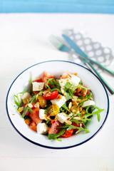 Fresh watermelon salad with arugula, feta, olives and tomato