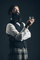 Scottish gentleman enjoying a glass of whiskey
