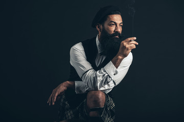 Handsome bearded Scotsman smoking a cigarette