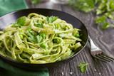 Tagliatelle pasta with spinach and green peas pesto