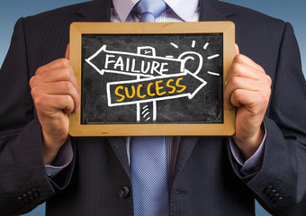 success or failure signpost hand drawing on blackboard