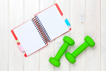 Dumbells and notepad for copy space