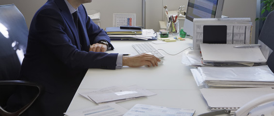 Italy, business man working in his office