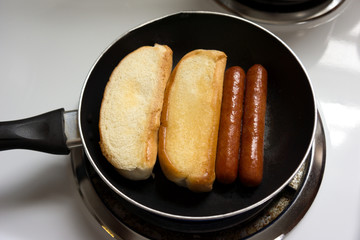 Hot Dogs Cooking In Pan
