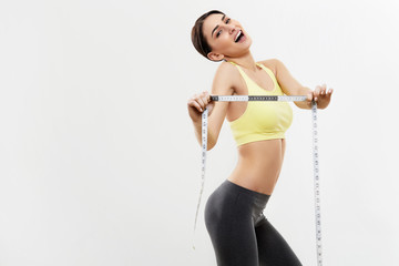 Diet. Beautiful Sporty Woman With Measuring Tape