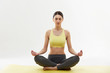 Yoga. Woman Meditating and Doing Yoga Against White background - 80969973