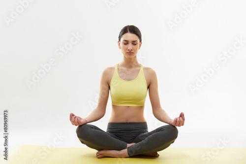 Yoga. Woman Meditating and Doing Yoga Against White background - 80969973