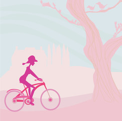 slim woman with bicycle in a park