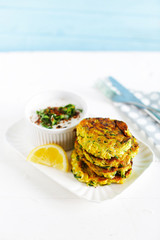 Vegetarian appetizer meal of zucchini burgers, fritters